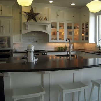 HGTV - kitchens - glossy, white, sawhorse, stools, floor to ceiling, white, shaker, kitchen cabinets, white, kitchen island, breakfast, bar, honed, black, granite, tops, pot filler, subway tiles, backsplash, schoolhouse, pendants, breakfast bar kitchen island, kitchen island breakfast bar,