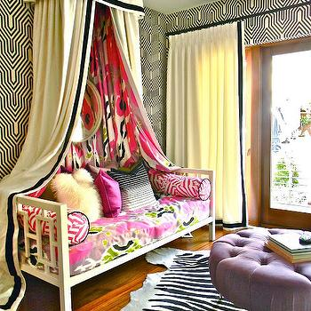Kriste Michelini Interiors - girl's rooms - zebra, cowhide, rug, purple, tufted, round, ottoman, caster legs, ivory, canopy, drapes, black, ribbon, trim, pink, bolster, pillows, west elm daybed, white daybed, window daybed, white window daybed, canopy daybed, Osborne & Little Minaret Wallpaper, West Elm Window Daybed, Z Gallerie Jupiter Chandelier,
