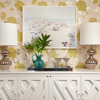 Chic dining room with yellow and gray floral wallpaper, white buffet cabinet and ...