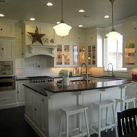 HGTV - kitchens - schoolhouse, pendants, floor to ceiling, kitchen cabinets, white, kitchen island, breakfast bar, honed, black, granite, tops, white, sawhorse, stools, subway tiles, backsplash, pot filler, sawhorse bar stools, white bar stools, white sawhorse bar stools,