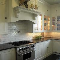 HGTV - kitchens - white, glass-front, shaker, kitchen cabinets, honed, black, granite, tops, pot filler, subway tiles, backsplash, subway tiles backsplash, subway tiles backsplash, subway tile kitchen,