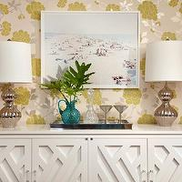 Chic dining room with yellow & gray floral wallpaper, white buffet cabinet and silver ...