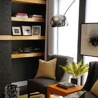 HGTV - living rooms - black, brick, fireplace, charcoal, gray, linen, wingback, modern, chairs, yellow, chevron, pillows, orange, lacquer, table, grizzle gray, sherwin williams grays, sherwin williams gray paint colors,