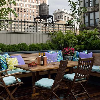 Fawn Galli Interiors - decks/patios - roof top deck, roof top patio, L shaped banquette, outdoor banquette, colorful pillows, teal chairs, teak dining table,
