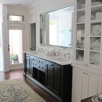 Abbott Moon - bathrooms: espresso, stained, double bathroom vanity, marble, top, beveled, mirror, white, glass-front, cabinet, gold, teal, blue, Persian, rug, double vanity, black double vanity, black double vanity with white marble countertop,