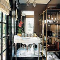 Elle Decor - bathrooms - chocolate, brown, walls, glossy, black, door, 2-leg, white, porcelain, washstand, marble, basketweave, tiles, floor, brass etagere, etagere, brass bookcase, brass tower, brass bookshelves, bathroom etagere, brass bathroom etagere,