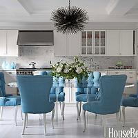 House Beautiful - dining rooms - blue, tufted, dining chairs, 1970s, lucite, oval, dining table, white, shaker, kitchen cabinets, kitchen island, marble, slab, tops, backsplash, dining chairs, tufted dining chair, velvet dining chairs, velvet tufted dining chair, blue dining chair, blue tufted dining chair,