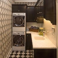 Abbott Moon - laundry/mud rooms - glossy, black, cabinets, marble, countertops, subway tiles, backsplash, stacked, washer, dryer, nickel, wall-mount, faucet, sink, white, black, checkered, tiles, floor,