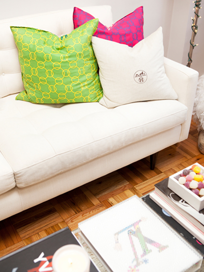 Teen Vogue - living rooms - Crate & Barrel Petrie Sofa, chic living room, jewel toned living room, abstract art, art over sofa, art above sofa, petrie sofa, crate & barrel sofa, white tufted sofa, handbag dustbag pillow covers, bag dustbag pillow, handbag dustbag pillows, pink and green pillows, parquet wood floors, coffee table books, white petrie sofa,