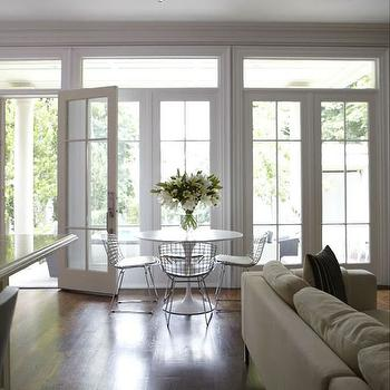 HGTV - dining rooms - wall of french doors, wall of transom windows, wall of french doors and transom windows, french doors, transom windows, marble saarinen table, marble saarinen dining table, Saarinen Dining Table, Bertoia Chair,