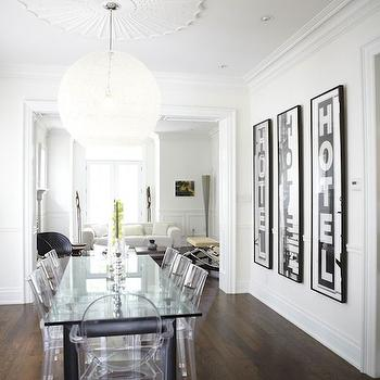 HGTV - dining rooms: white dining room, white and black dining room, black dining table, ghost chairs, ghost captain chairs, lucite chairs, lucite dining chairs, vintage signs, dining room built ins, dining room built in cabinets,