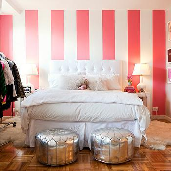 Teen Vogue - bedrooms - accent wall, striped accent wall, vertical striped wall, vertically striped wall, white and pink accent wall, white and pink striped wall, white and pink striped accent wall, girls room accent wall, white tufted headboard, white headboard, teen girls room, teen girls bedroom, white and pink teen room, shag lumbar pillow, white shag lumbar pillow, white bed skirt, parquet floor, parquet wood floors, silver moroccan poufs, mirrored bookcase, quatrefoil bookcase, white quatrefoil bookcase, ikea rens sheepskin, ikea sheepskin, ikea pelt, West Elm Parsons End Table, Home Decorators Reflections Bookcase,