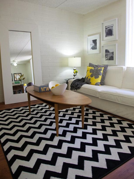 HGTV - living rooms - Milliken Black and White Vibe Rug, Target Dwell Studio Peony Pillow, coffee table, mid century modern coffee table, oval coffee table, wood oval coffee table, oval wood coffee table, black and white rug, white and black rug, chevron rug, black and white chevron rug, white and black chevron rug, ikea mongstad mirror, mongstad mirror, white floor mirror, white mongstad mirror, floor mirror, slipcovered sofa, white slipcovered sofa, striped pillow, black and white pillow, black and white striped pillow, ikea floor mirror, exposed brick wall, white exposed brick wall, white brick walls, living room brick wall, brick wall living room, white brick wall living room,