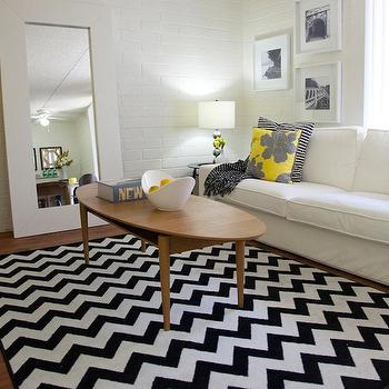 HGTV - living rooms - coffee table, mid century modern coffee table, oval coffee table, wood oval coffee table, oval wood coffee table, black and white rug, white and black rug, chevron rug, black and white chevron rug, white and black chevron rug, ikea mongstad mirror, mongstad mirror, white floor mirror, white mongstad mirror, floor mirror, slipcovered sofa, white slipcovered sofa, striped pillow, black and white pillow, black and white striped pillow, ikea floor mirror, exposed brick wall, white exposed brick wall, white brick walls, living room brick wall, brick wall living room, white brick wall living room, , Milliken Black and White Vibe Rug, Target Dwell Studio Peony Pillow,