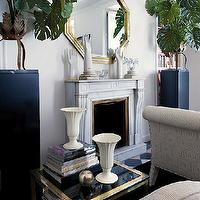Nuevo Estilo - living rooms - built-ins, flanking, fireplace, gold, octagon, mirror, gold, black, end table, black, white, checkered, tiles, floor, octagon mirrors, octagon mirror, gold octagon mirror, gold octagonal mirror,