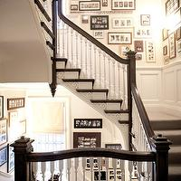 Country Living - entrances/foyers - photo wall, photo walls, staircase photo wall, stairwell photo wall, cream walls, wainscoting, staircase wainscoting, stairwell wainscoting, espresso stained hand rail, espresso hand rail, wood spindles, white spindles, white wood spindles,