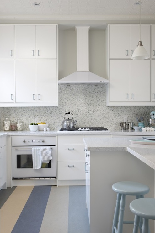Sarah Richardson Design - kitchens - Para Paints - Snowfall - Ikea Cabinets, Eco by Cosentino White Diamond, ikea cabinets, ikea kitchen cabinets, white diamond countertops, white countertops, white cabinets with white countertops, white kitchen cabinets with white countertops, mosaic tile, mosaic tile backsplash, mosaic backsplash, mosaic kitchen backsplash, mosaic kitchen tile, ikea oven, ikea appliances, ikea kitchen appliances, framed chalkboard, turquoise chalkboard, tin ceiling, tin kitchen ceiling, white tin ceiling, white tin kitchen ceiling, powder blue stools, powder blue counter stools, L shaped kitchen island, L shaped island, gray walls, gray paint color, kitchen paint colors, blue and gray rug, blue and gray striped rug,