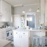 Sarah Richardson Design - kitchens - ikea cabinets, ikea kitchen cabinets, white diamond countertops, white countertops, white cabinets with white countertops, white kitchen cabinets with white countertops, mosaic tile, mosaic tile backsplash, mosaic backsplash, mosaic kitchen backsplash, mosaic kitchen tile, ikea oven, turquoise accents, turquoise blue accents, ikea appliances, ikea kitchen appliances, framed chalkboard, turquoise chalkboard, tin ceiling, tin kitchen ceiling, white tin ceiling, white tin kitchen ceiling, powder blue stools, powder blue counter stools, L shaped kitchen island, L shaped island, gray walls, gray paint color, kitchen paint colors, blue and gray rug, blue and gray striped rug, Ikea Cabinets, Eco by Cosentino White Diamond,