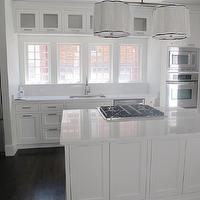 White &amp; Gold Design - kitchens - cambria torquay, cambria torquay quartz, cambria torquay countertops, cambria torquay quartz countertops, cambria torquay kitchen countertops, torquay cambria quartz, white cabinets, white dove cabinets, white dove kitchen island, benjamin moore white dove cabinets, marble alternatives, marble countertop alternatives, gas cooktop, kitchen island cooktop, robert abbey pendants, scalloped chandelier, scalloped light pendant, bank of windows, kitchen windows, satin nickel faucet, satin nickel gooseneck faucet, , Robert Abbey Robert Abbey Axis - Four Light Double Pendant,