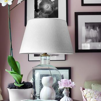 Decor Demon - living rooms - blush pink, blush pink walls, blush pink paint, blush pink paint colors, photo wall, black and white photo wall, black accent table, marble accent table, black marble accent table, glass lamp,