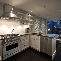 Cutler Design Construction - kitchens - open kitchen, open floor plan kitchen, kitchen with no top cabinets, kitchen with no upper cabinets, shaker cabinets, white shaker cabinets, white lower cabinets, white base cabinets, floating shelves, kitchen shelves, kitchen floating shelves, shelves flanking kitchen hood, white stove, white viking stove, white range, white viking range, subway tile, subway tile backsplash, subway tile with gray countertop, gray countertop with subway tile, kitchen peninsula, kitchen peninsula sink, kitchen peninsula dishwasher, kitchen lounge, kitchen lounge space, ferm living wallpaper, white sofa, slate blue sofa, white kitchen and dark wood floors, white kitchen cabinets with dark wood floors, Ferm Living Ribbed Wallpaper in Black and White,