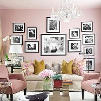 Decor Demon - living rooms - Ralph Lauren - Early Morning - pink walls, pink paint, pink paint color, cowhide ottoman, ikea footstool, ikea cowhide ottoman, pink living room, blush pink, blush pink walls, blush pink paint, blush pink paint colors, photo wall, black and white photo wall, black accent table, marble accent table, black marble accent table, glass lamp, art deco coffee table, glass top coffee table, pink chairs, pink tufted chair, pink velvet chair,