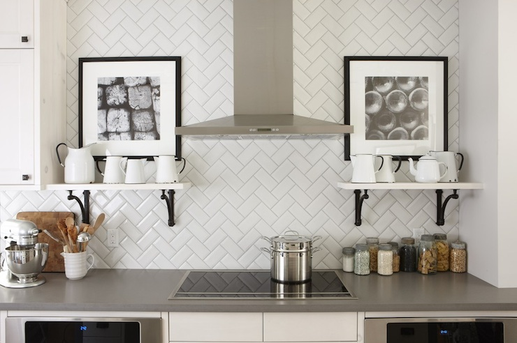 Sarah Richardson Design - kitchens - Silestone Grey Expo, subway tile patterns, subway tile backsplash, white subway tile, subway tile kitchen, white subway tile backsplash, white subway tile kitchen, herringbone subway tile backsplash, herringbone subway tile, subway tile backsplash design, ikea cabinets, ikea kitchen cabinets, white ikea cabinets, white ikea kitchen cabinets, kitchen hood, induction cooktop, kitchen shelves, white shelves, iron corbels, gray counters, gray countertops, kitchen art,