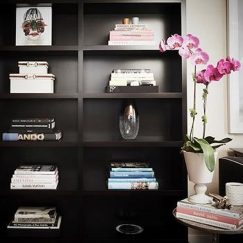 Carlyle Designs - living rooms - office, home office, deh, bookcase, office bookcase, ebony bookcase, black bookcase, black sofa, black and white sofa, black sofa with white piping, urn vase, white urn vase, pedestal urn vase, marble accent table, black marble accent table, pink orchid,