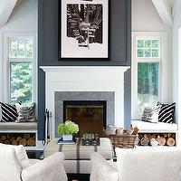 Style at Home - living rooms - fireplace seating, living room, vaulted ceiling living room, living room vaulted ceiling, fireplace window seats, window seats, living room window seats, built in window seats, fireplace built ins, built in firewood storage, firewood cubbies, built in firewood cubbies, blue fireplace wall, fireplace wall, iron lantern, carriage lantern, living room lantern, french ottoman, vintage grain sack ottoman, vintage french ottoman, white chairs, wingback chairs, suede chairs, white suede chairs, white wingback chair, suede wingback chair, white suede wingback chair,