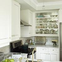 Sarah Richardson Design - kitchens - small kitchen, small chic kitchen, chic small kitchen, shaker cabinets, white shaker cabinets, mirror backsplash, cabinet backsplash, mirror cabinet backsplash, mirrored backsplash, mirrored cabinet backsplash, antiqued mirror backsplash, cabinet backsplash, antiqued mirror cabinet backsplash, antiqued mirrored backsplash, antiqued mirrored cabinet backsplash, upper cabinets, open upper cabinets, display cabinet, kitchen display cabinet, kitchen peninsula, brass faucet, brass kitchen faucet, octagon tile, marble octagon tile, octagon tile backsplash, marble octagon tile backsplash, octagon backsplash, octagon kitchen backsplash, marble octagon backsplash, marble octagon kitchen backsplash,