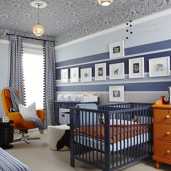 Sarah Richardson Design - nurseries - blue and orange nursery, blue walls, blue paint color, blue paint, nursery paint, nursery paint colors, blue nursery colors, blue nursery paint colors, ikea chair, arkiva swivel chair, orange chair, modern orange chair, black accent table, ikea bench, blue ikea bench, blue bench, blue and black bench, blue and black ikea bench, blue pillows, framed chalkboard, paisley wallpaper, gray and black wallpaper, gray and black paisley wallpaper, wallpapered ceiling, ceiling wallpaper, changing table, striped nursery, striped nursery walls, blue striped walls, blue striped nursery, blue striped nursery walls, blue changing table, painted changing table, boys changing table, nursery art, boys nursery art, blue boys nursery, blue nursery, Para Paints Fanfare, Para Paints Beyond The Sea, Para Paints Cashmere, Paints Carved Pumpkin, Para Paints Convertible, Ikea Gulliver Crib, Ikea Stockholm Footstool - Cowhide, Thibaut Charlton Paisley Wallpaper Tidewater Blue, Ikea Arvika Swivel Chair,