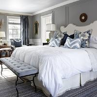 Sarah Richardson Design - bedrooms: sarah richardson bedroom, sarah richardson bedrooms, gray walls, gray wainscoting, gray paint, gray bedroom paint, gray bedroom walls, sarah richardson headboard, sarah richardson chairs, chevron pillows, blue chevron pillows, white and blue chevron pillows, ivory headboard, studded headboard, nailhead headboard, ivory studded headboard, ivory nailhead headboard, blue bench, tufted bench, blue tufted bench, iron bench, bedroom bench, bench at foot of bed, black nightstands, blue rug, rug under bed, blue chairs, blue floral chairs, small sunburst mirror, mirror over bed, mirror above bed,