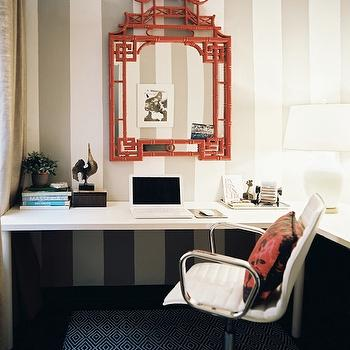 Lonny Magazine - dens/libraries/offices - faux bamboo mirror, bamboo mirror, pagoda mirror, red faux bamboo mirror, red bamboo mirror, red pagoda mirror, red mirror, red bamboo mirror, striped walls, white and silver walls, vertical striped walls, vertically striped walls, white and silver striped walls, L shaped desk, white desk, crate & barrel desk chair, white leather desk chair, diamond rug, navy blue rug, navy blue diamond rug, Horchow Pagoda Mirror - Red, Crate & Barrel Ripple Ivory Leather Office Chair,