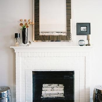 Lonny Magazine - living rooms - garden stools, mirror above fireplace, mirrors above fireplace, mirror over fireplace, mirrors over fireplace, fireplace mirror, fireplace mirrors, silver garden stool, zebra mirror, williams sonoma mirror, brick fireplace, white fireplace, white brick fioreplace, Fulton Zebrawood Wall Mirror,