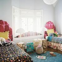 Lonny Magazine - girl's rooms: eclectic girls room, eclectic girls bedroom, urban outfitters rug, peacock rug, blue peacock rug, round peacock rug, twin headboard, pink headboard, pink twin headboard, twin pink headboard, colorful bedding, girls bedding, girls headboards, girls rugs, hamper, african lidded basket, gold accent table, stump table, tree stump table, golden stump table, gold stump table, ikea lamps, brasa lamp,