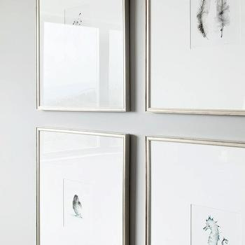 Kelly Deck Design - entrances/foyers - gallery frames, silver gallery frames, art wall, seahorse art, feather art,  Soft gray walls and silver