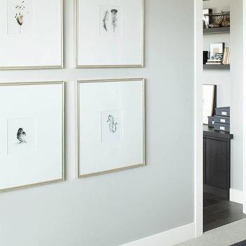 Kelly Deck Design - entrances/foyers - gallery frames, silver gallery frames, art wall,  hall with pale gray walls paint color and art in silver