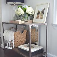 One Story Building - living rooms - skirted table, skirted console table, wisteria table, wisteria skirted table, wisteria skirted console table, linen skirted table, linen skirted console table, gallery frames, ikat bowl, gold ikat bowl, white and gold bowl, white and gold ikat bowl, glass column lamp, column table lamp, dark stained wood floors, black lamp shade, Crate &amp; Barrel Manning Lamp, Home Decorators Industrial Louis Console, West Elm Large Curved Basket, West Elm Raffia Tray,