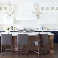 Kelly Deck Design - kitchens - white cabinets, shaker cabinets, white shaker cabinets, upper cabinets, upper kitchen cabinets, lower cabinets, lower kitchen cabinets, white upper cabinets, blue cabinets, blue kitchen cabinets, blue lower cabinets, marble tops, marble countertops, white backsplash, white kitchen backsplash, paneled kitchen hood, paneled fridge, paneled refrigerator, microwave nook, built in microwave, crystal chandelier, kitchen island chandelier, kitchen island crystal chandelier, kitchen island with baluster legs, stained kitchen island, oak island, oak kitchen island, gray bar stools, gray barstools, gray counter stools, gray velvet stools, gray velvet bar stools, gray velvet barstools, gray velvet counter stools,