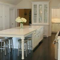 West End Cabinet Company - kitchens - kitchen island, marble kitchen island, white kitchen island, marble top island, marble top kitchen island, kitchen island with turned legs, shaker cabinets, white shaker cabinets, marble slab backsplash, marble countertops, dark stained wood floors, crate & barrel stools, crate & barrel bar stools, crate & barrel barstools, crate & barrel counter stools, spin barstools, glass front hutch, built in hutch, glass front kitchen hutch, kitchen hutch, long kitchen island, farmhouse sink, kitchen island sink, kitchen island farmhouse sink, u shaped kitchen, Crate & Barrel Spin Counter Stool,