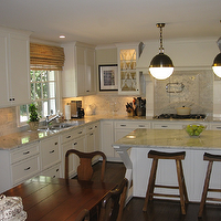 West End Cabinet Company - kitchens - hicks pendants, kitchen hicks pendants, island hicks pendants, hicks kitchen island pendants, kitchen island pendants, x kitchen island, x base island, x base kitchen island, white kitchen island, marble top island, marble top kitchen island, sawhorse stools, sawhorse counter stools, kitchen hood, tapered kitchen hood, white kitchen hood, kitchen hood corbels, marble countertops, marble subway tile, marble subway tile backsplash, swing arm pot filler, glass front kitchen cabinets, kitchen tv, double ovens, L shaped kitchen eat in kitchen, rectangular dining table, swedish dining chairs,