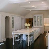 West End Cabinet Company - kitchens - kitchen island, marble kitchen island, white kitchen island, marble top island, marble top kitchen island, kitchen island with turned legs, shaker cabinets, white shaker cabinets, marble slab backsplash, marble countertops, dark stained wood floors, crate & barrel stools, crate & barrel bar stools, crate & barrel barstools, crate & barrel counter stools, spin barstools, glass front hutch, built in hutch, glass front kitchen hutch, kitchen hutch, long kitchen island, farmhouse sink, kitchen island sink, kitchen island farmhouse sink, u shaped kitchen, arched doorway, french doors, kitchen french doors, , Crate & Barrel Spin Counter Stool,