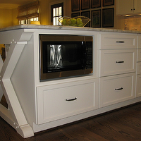 Creamy white cabinets in X base kitchen island with built-in microwave nook and marble ...