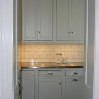 West End Cabinet Company - kitchens - butler pantry, butlers pantry, butler pantry design, butlers pantry design, subway tile, subway tile backsplash, subway tile with dark grout, shaker cabinets, white shaker cabinets, stainless steel countertops,
