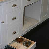 West End Cabinet Company - kitchens - hidden pet bowls, kitchen island pet bowls, sliding pet food bowls, sliding pet food bowls, kitchen island, white kitchen island, dog bed, kitchen island dog bed, built in dog bed, marble ocuntertops,