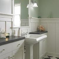 Goforth Gill Architects - bathrooms - seafoam green walls, seafoam green, board and batten, ivory board and batten, off white board and batten, cream board and batten, pedestal sink, framed mirror, ivory cabinets, bathroom cabinets, ivory bathroom cabinets, charcoal gray, charcoal gray countertops, black and white floors, checkered floors, black and white checkered floor, black and white checkered tiles,