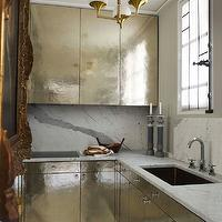 Elle Decor - kitchens - hammered cabinets, hammered kitchen cabinets, silver cabinets, silver kitchen cabinets, hammered silver cabinets, hammered silver kitchen cabinets, calcutta marble, calcutta marble counters, calcutta marble countertops, calcutta marble backsplash, calcutta marble slab backsplash, electric cooktop, modern sink, modern kitchen sink, rococo mirror, gold mirror, gold rococo mirror, brass and opaline light fixture,