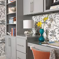 Martha O'Hara Interiors - dens/libraries/offices - home office, office, gray office, gray cabinets, modern gray cabinets, office cabinets, gray office cabinets, built in desk, gray desk, built in desk, gray built in desk, orange accents, desk chair, gray and orange chair, teal, teal vase, contemporary vase, mercury glass, mercury glass lamp, modern hardware, cabinet hardware, modern cabinet hardware, floral wallpaper, modern floral wallpaper, white and gray wallpaper, white and gray floral wallpaper,