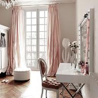 Elle Decor - bedrooms - french armoires, french wardrobes, white armoire, white wardrobes, herringbone wood floors, dressing rooms, pink dressing rooms, glam dressing rooms, dressing room french doors, closet french doors, french doors in dressing rooms, french doors in closets, floor to ceiling french doors, floor to ceiling drapery, pink drapes, pink silk drapes, pinch-pleat drapes, silk pinch-pleat drapes, pink pinch-pleat drapes, silk curtains, silk dupioni curtains, pink dupioni curtains, pink dupioni drapes, crown molding millwork, herringbone floors, herringbone wood floors, herringbone hardwood floors, white tufted ottomans, round tufted ottomans, dressing room ottomans, closet ottomans, round tufted ottomans, french vanity chairs, pink vanity chairs, tufted vanity chairs, pink tufted vanity chairs, oval-back vanity chairs, french oval-back vanity chairs, white lacquer vanity, x-base vanity, polished nickel vanity, lighted mirrors, lighted vanity mirrors, vanity mirrors, dressing room chandeliers, closet chandeliers, pink drapes, pink curtains, pink silk curtains, pink silk drapes,