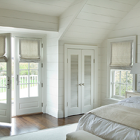 Monochromatic cottage bedroom with white tongue and groove walls and bedroom vaulted ...